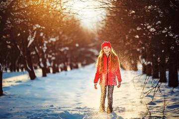 Beauty Teenager Girl in frosty winter Park. Outdoors. Sunny day.