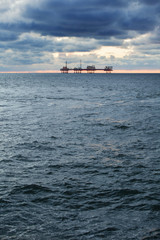 Oil platform on the North Sea at sunset