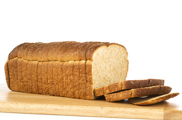 Sliced WHole Wheat Loaf of Bread on Cutting Board