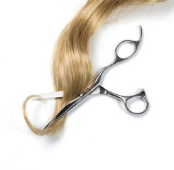 Long blond hair and scissors