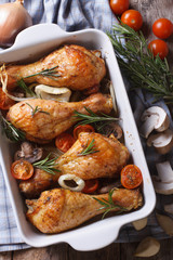 Baked chicken legs and ingredients. vertical top view close-up