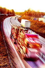 Truck driving in sunset with timber load
