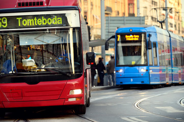 Bus and tram in traffic