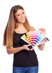 Young girl holding color swatch
