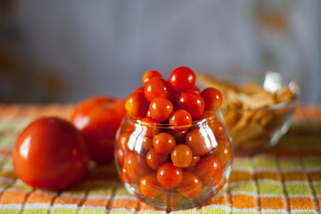 Still small preserved cherry tomatoes in a glass vase