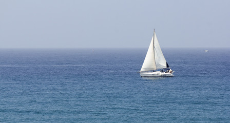 boat with white sails