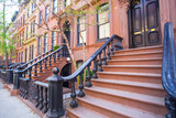 Old houses with stairs in the historic district of West Village