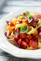 Tagliatelle with peppers, red onion and roasted prosciutto