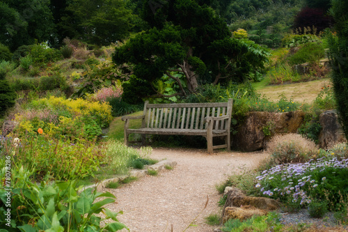 Wooden bench in a beautiful park garden. - 78078286