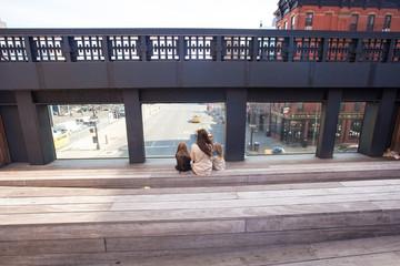 Little girls and mother enjoy sunny day on New York's High Line