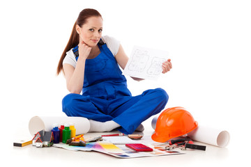 Female construction worker with plan of house.
