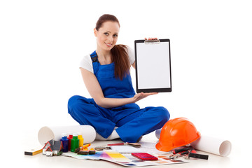Female construction worker shows blank clipboard.