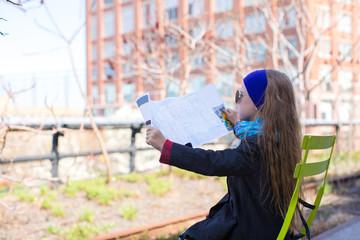 Adorable little girl enjoy sunny day on New York's High Line