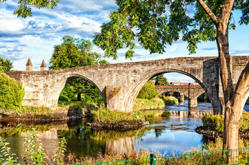 The old stone bridge of Stirling. Summertime outdoors.