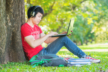 education, technology and internet concept - smiling teenager us