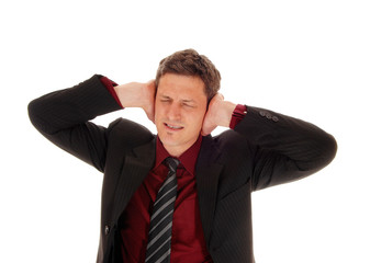 Man covering his ear's.