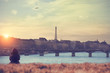 Seine river and Eiffel tower with lonesome girl.