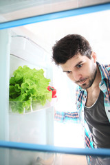 Searching something in refrigerator