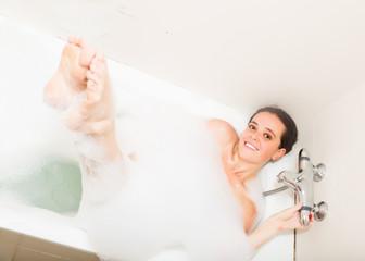 woman laying with foam in bath