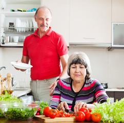 senior man  and  woman  doing chores