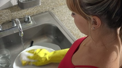 Woman Doing Chores And Washing Dishes At Home