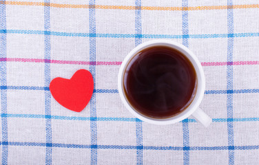 Cup of tea and heart on the table.