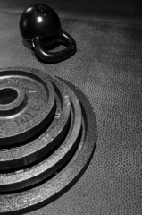 Plates stacked with kettle bell
