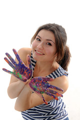 Woman smiling and showing her hands painted in colorful paint