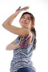 Girl standing shows her hands painted with acrylic color