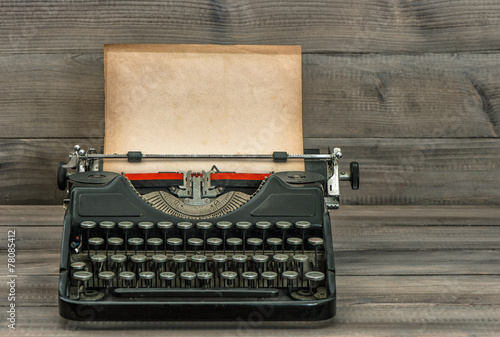 Retro antique typewriter with grungy textured paper page. vintage styl