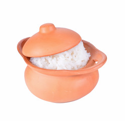 Rice in a clay pot on a white background