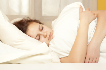 Woman sleeps in the bedroom