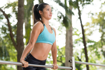 Doing exercises on gym bar
