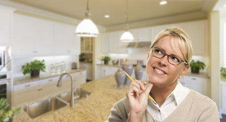 Daydreaming Woman with Pencil Inside Beautiful Kitchen