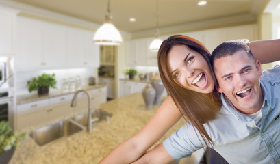 Playful Young Military Couple Inside Beautiful Custom Kitchen