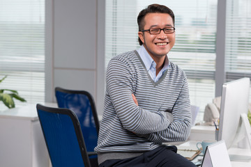 Cheerful Vietnamese businessman