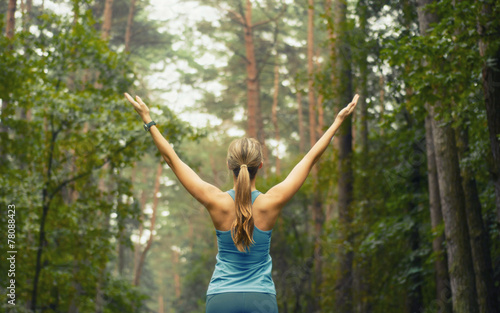 healthy lifestyle fitness sporty woman early in forest area - 78088423