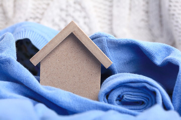 wooden toy house - the concept of housing purchase mortgage