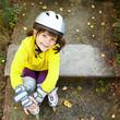 Little girl in roller skates at a park - 78089235