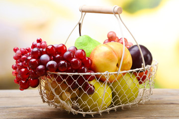 Assortment of juicy fruits in wicker basket