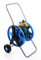 Garden hose on wheels isolated on white