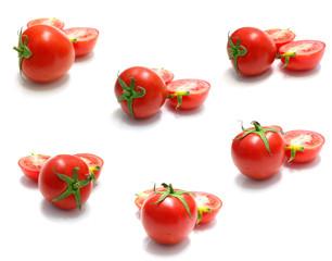 tomato and slices of tomato on white background
