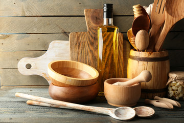Wooden kitchen utensils with glass bottle of olive oil