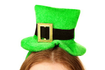 St. Patricks hat on head, isolated on white