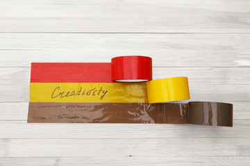 Bonded tape on wooden planks background