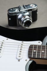 Black and white guitar frets with vintage photo camera