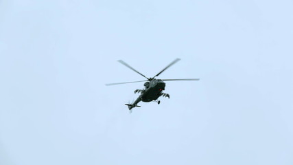 One helicopter flying in the sky during military parade