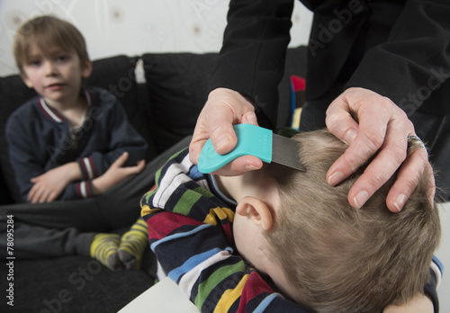 Youngsters getting head inspected for lice - 78095284
