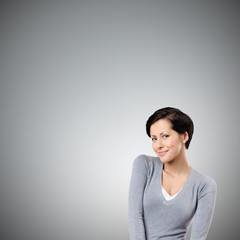 Smiley woman, isolated on grey background
