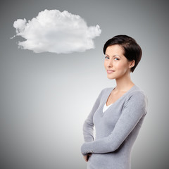 Smiley cheerful woman with cloud, on grey